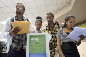 u s adds solid jobs unemployment rate rises to  people seek employment at a job fair for the homeless at the los angeles mission in