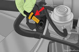 how to replace a coolant temperature sensor yourmechanic advice coolant sensor being reinserted
