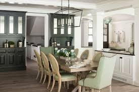 green dining room colors. Charming Green And Brown Cottage Dining Room Is Illuminated By A Darlana Linear Lantern Hung Over Wood Trestle Table Seating Wingback Head Colors
