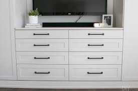 gray and beige shaker style cabinets on this master bedroom built in unit