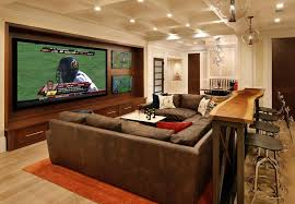 home theater room design with table behind the sofa