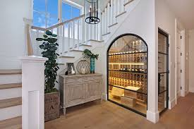 Awesome contemporary wine cellar under the sleek staircase