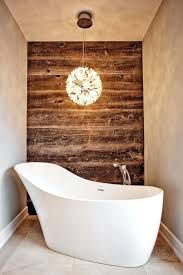 wood wall bathroom worn wood wall contrasts with a modern bathtub and chandelier wood wall mounted bathroom cabinets