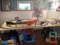 with the help of my brother in law bill i got my train table up and running last week it is 5 x 9 and has a layout that is called round n round the