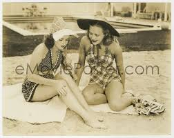 eMoviePoster.com: 4d828 ROSEMARY LANE/PRISCILLA LANE 7.5x9.25 still 1938  sisters relaxing at the beach by Welbourne!