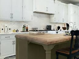 kitchen cabinetry finishes kitchen built with inset shaker cabinets in white with a moss green island