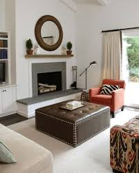 comfy family room furniture with brown tufted coffe table near fireplace plus metal adjustable floor lamp awesome family room lighting