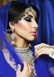indian women wear diffe types of jewellery for their weddings here there are statement head neck and hand pieces seen as well as thick eye makeup