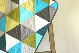 craftyblossom: aqua and olive :: a pyramids baby quilt. & You're looking at my first equilateral triangle quilt. I love the colors  and composition, the one thing I don't love is sewing so many seams on the  bias. Adamdwight.com