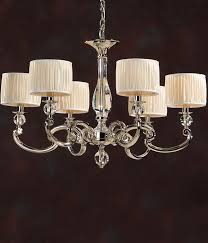 solid brass and crystal chandelier with round off white pleated shades