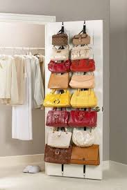 purses on the inside of a closet door