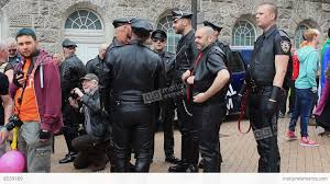 ism group of men in leather suits during pride stock footage