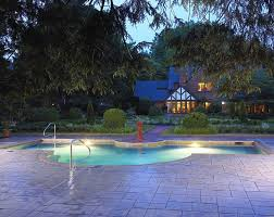 amazing modern rectangular pool with beautiful lighting and stamped concrete deck beautiful lighting pool