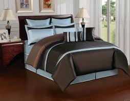 brown wooden queen size bed with aqua blue and brown bedding added brown wooden table lamp placed on wooden floor as well as blue and green bed sheets also
