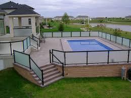 raise patio with privacy panels aroun pool in fargo nd raised paver patio around swimming pool above