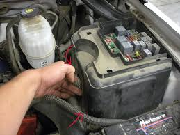 duramax cab removal diy chevy and gmc duramax diesel forum 22 the fusebox cover removed pull up a chair you ve got some wires to unhook start by removing both wires on each side of the large fuse using a