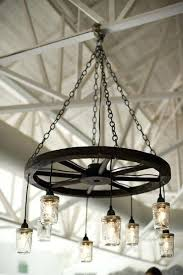wagon wheel light wagon wheel chandeliers are gorgeous lighting for a barn wedding or rustic th wagon wheel light
