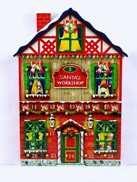 this 14 inch high wooden advent calendar is so very bright and festive you even get to see one of his elves king out