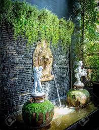 bronze lion head indoor water fountain wall decoration stock photo 105069256
