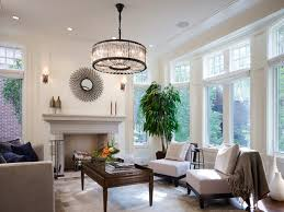 large elegant open concept dark wood floor living room photo in chicago with white walls
