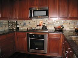 Contemporary Kitchen Backsplash Cherry Cabinets Black Counter With Tile Ideas In Decorating