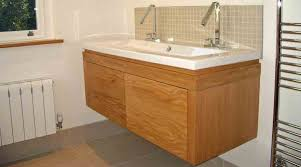 a bespoke wooden vanity unit with large double sink and twin taps