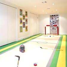 example of a trendy underground basement design in new with white walls hockey rink rug rugby