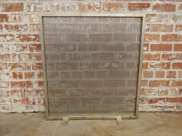 minimalist fireplace screen with silver tea frame and stainless steel screen