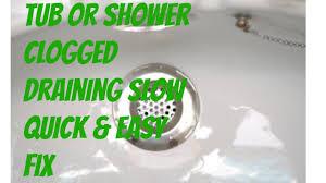 bathroom tub shower clogged with hair slow drain easy fix
