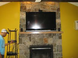 how to install mounting tv above fireplace for living room stone walls design ideas with