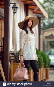 Elegant Asian Elegant Asian Woman In White Dress With Hat On The Street Girl