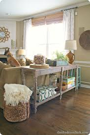 everett foyer table world market - idea for dividing family room from  kitchen. End table behind couch