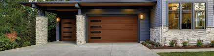 if you re looking for a beautiful faux wood garage door that complements your mid century or modern home style then you ll love the canyon ridge modern