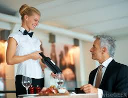 a hostess may introduce a restaurants wine list to patrons jobs as a hostess