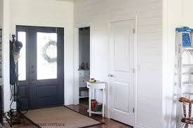 the white kitchen wall by the wood grain cottage