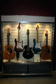 my guitar display cabinet created from a commercial slat wall and 5 x hangers slatwall hanger