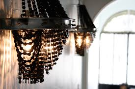 it s about time bike culture got a little bit of an upgrade artist ina fontoura has been making stunning chandeliers out of bike chains that look lik