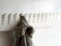dazzling white wall mounted coat rack