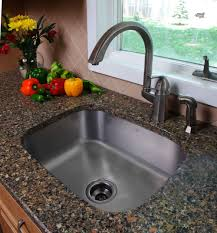 kitchen stainless steel drop in sink square design feature granite countertop and wooden vintage kitchen cabinet include brass iron cast arched faucet
