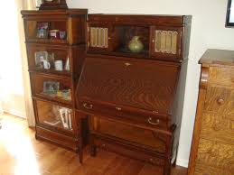 rare globe wernicke bookcase with desk drawer base and top locker section and