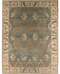 a blue aqua ivory and tan rug carpet available through david e