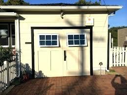 swinging garage door swing carriage garage doors carriage swinging garage doors non warping patented honeycomb panels swinging garage door