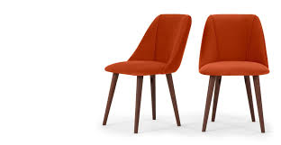 a set of 2 dining chairs in flame orange velvet