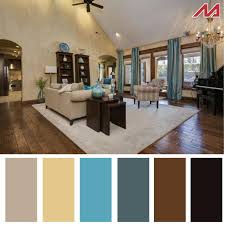 space living room olive: wide plank hardwoods provide a solid base for the tans and blue to shine through in this timberbrook living room floor to ceiling drapes bring the focus to