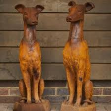 cast iron pair of sitting whippet dog