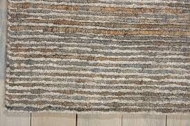 loop texture hand woven from an eco friendly blend of jute and bamboo rayon with the perfect balance of matte and shine finishes this mesa area rug