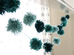 garlands instantly take a party up a notch especially when they re homemade this pom pom one is a really easy one to make requiring no special tools or