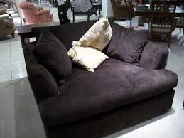 big comfy oversized armchair where you can snuggle up with a good book blanket and