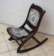 i own a chair just like this identical they are folding rockers