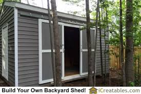 sliding barn doors installed on shed by hanging them on the barn door hardware